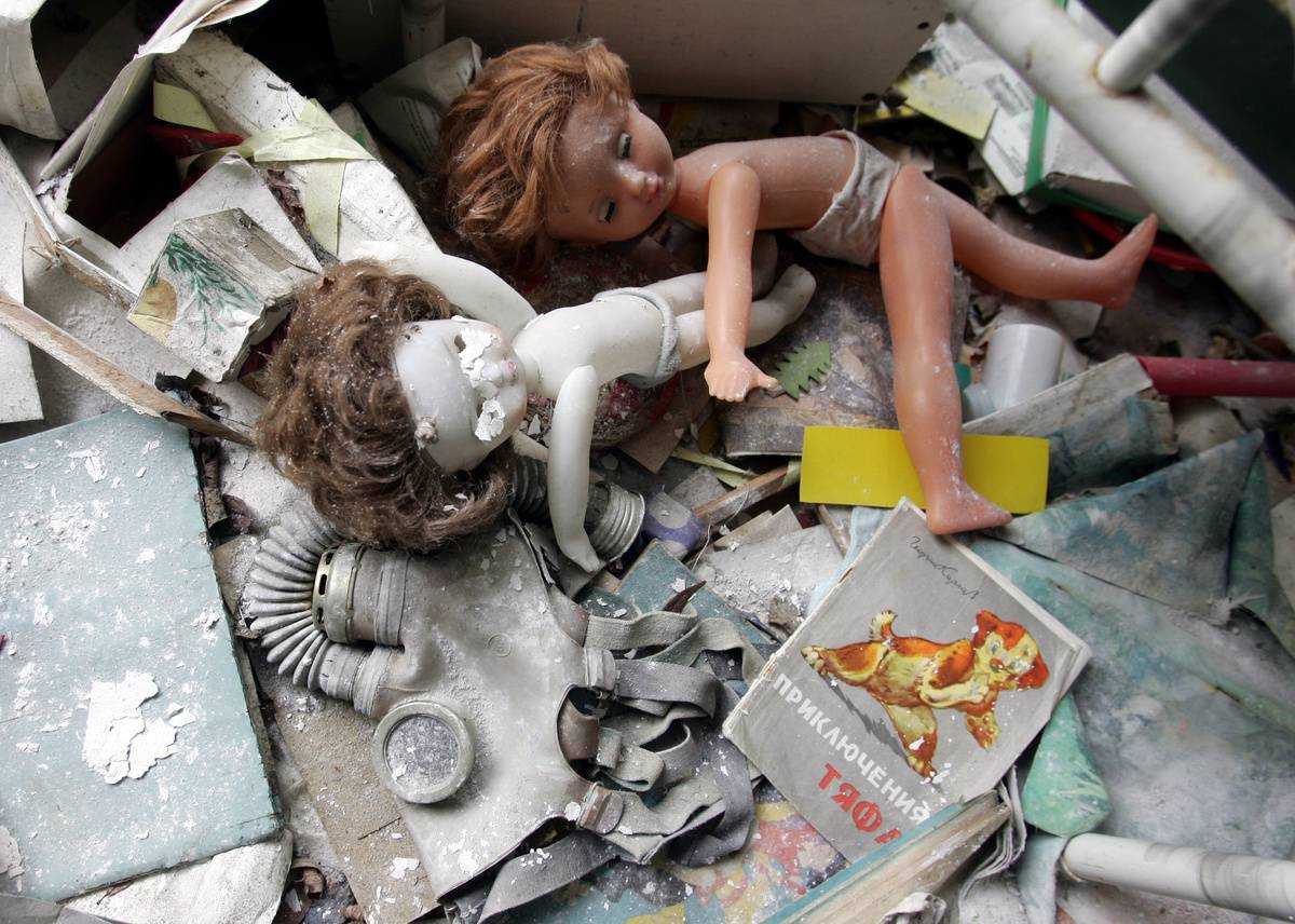 Dolls and a gas mask are left behind in a kindergarten in the ghost town of Pripyat near Chernobyl's nuclear power plant